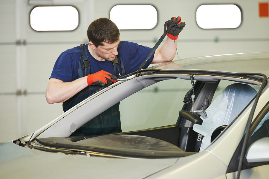 professional auto glass expert working on fleet services