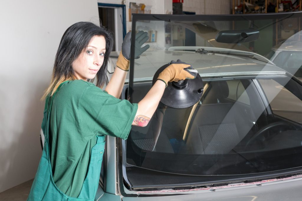 professional auto glass expert working on on-site service